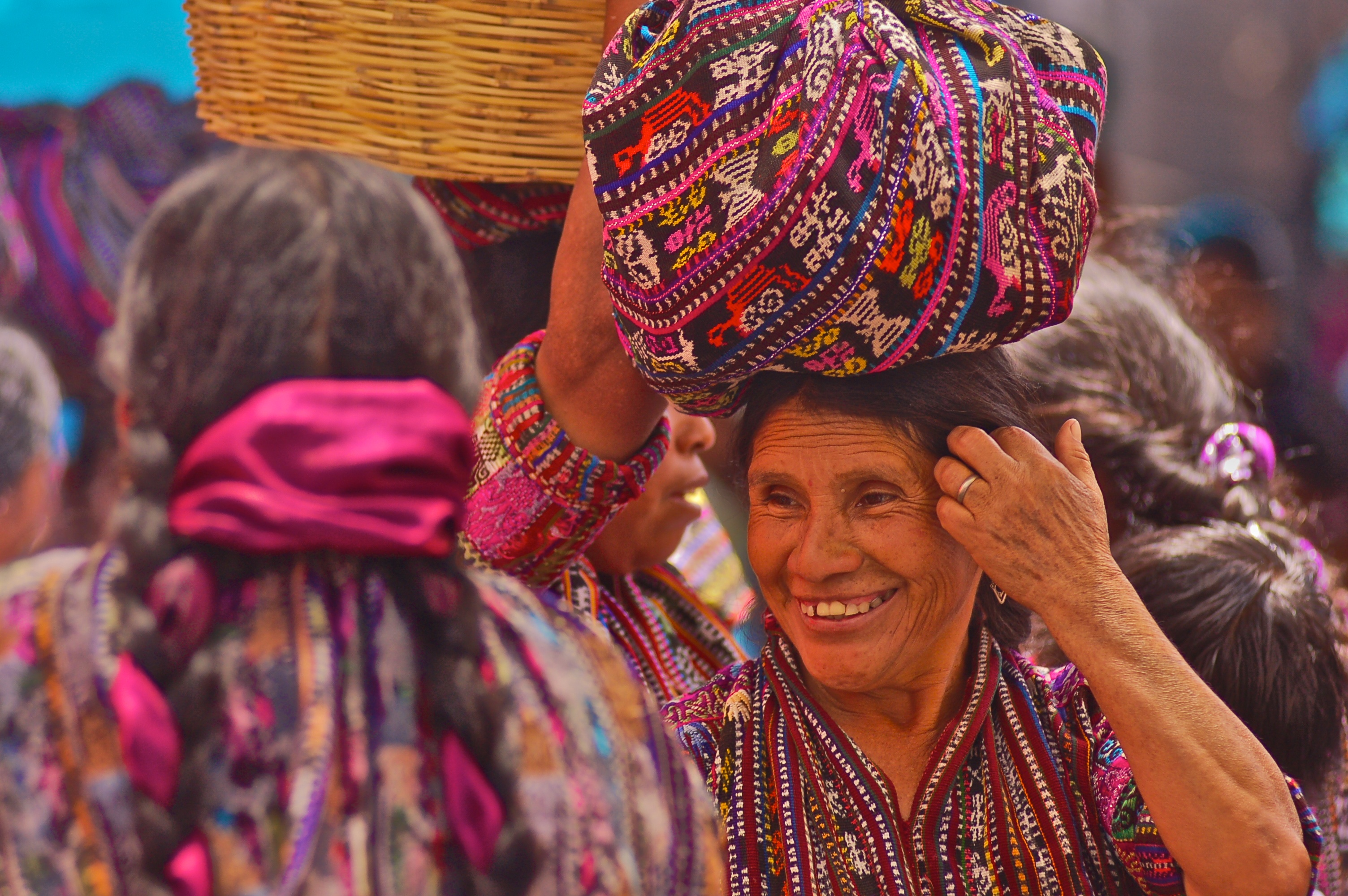 A women carrying goods in the market at Solala.