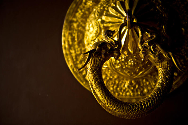 Doorknob dragon in Nepal. Copyright Aloha Lavina.