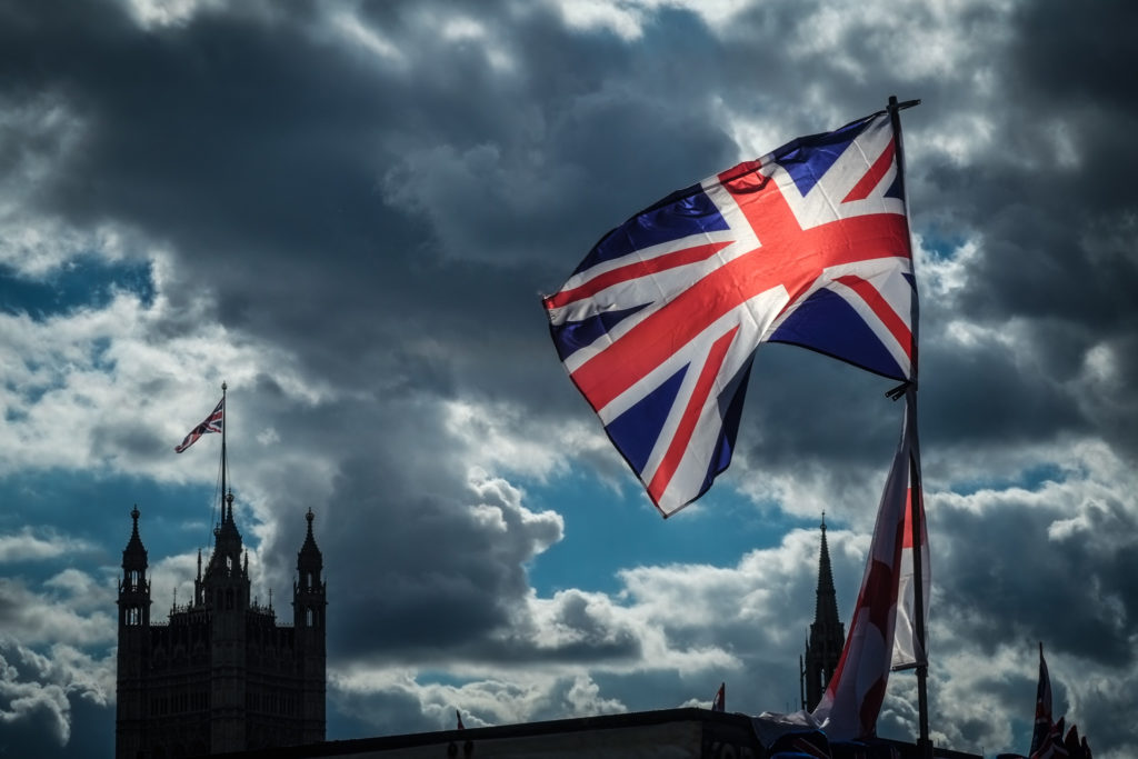 Union Flag with parliament behind on a stormy afternoon