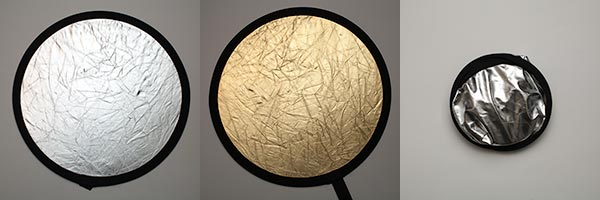 This reflector is silver on one side, gold on the other; folds down nicely.