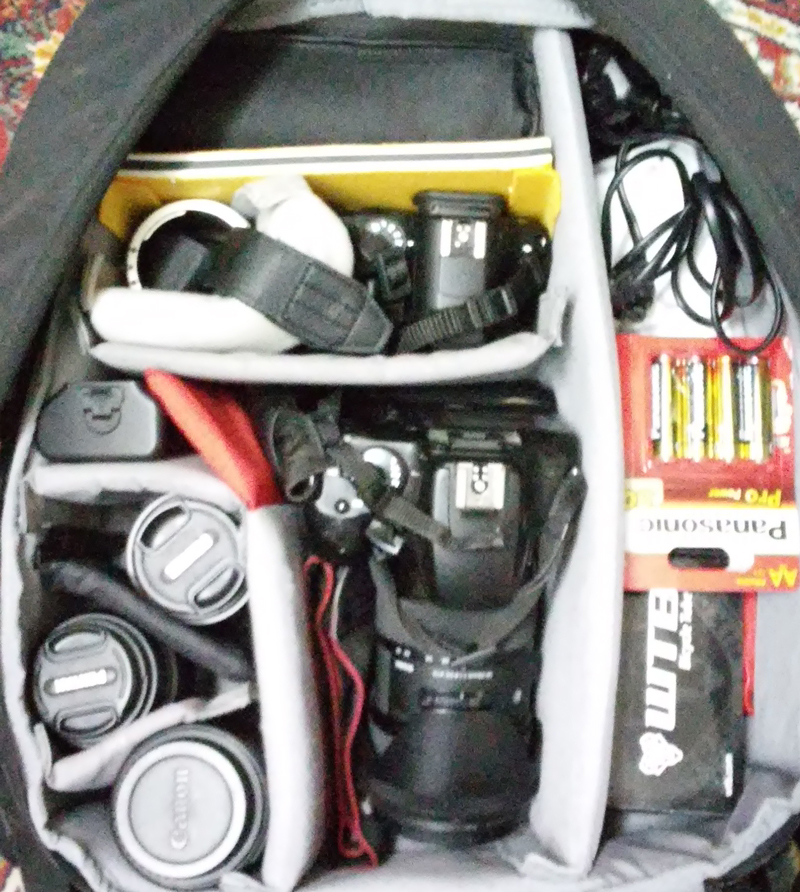 This is how the backpack looked like when I prepared it for the trip. On the left side you can see the lenses for the Pentax and the Canon DSLRs. In the middle is my trusty old Canon EOS 1000D with the Sigma 18-35 mounted on it. Above the Canon lies the Pentax K-50, left of it are the macro tubes, and right above it is the Yongnuo YN-565 EXII flash. On right side, Sanyo battery charger, the chargers for the both cameras, spare bicycle tube, tools for changing the bicycle tube. In the compartment which isn't in the picture (sorry about that) there is a spare battery for the Canon, notepad, pens, tripod shoe, lens cleaning cloth, and the waterproof tent.