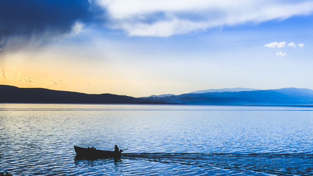 Lake scene during blue hour. Shot in Ohrid, Macedonia. Photo by Dzvonko Petrovski. All rights reserved.