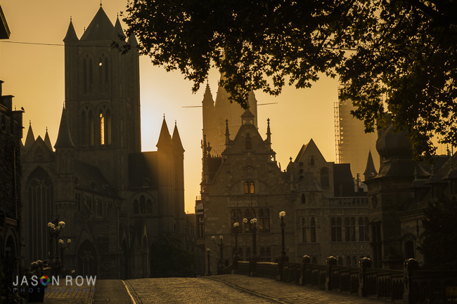 Sunrises behind the medeival city of Ghent as seen from St Michaels Bridge
