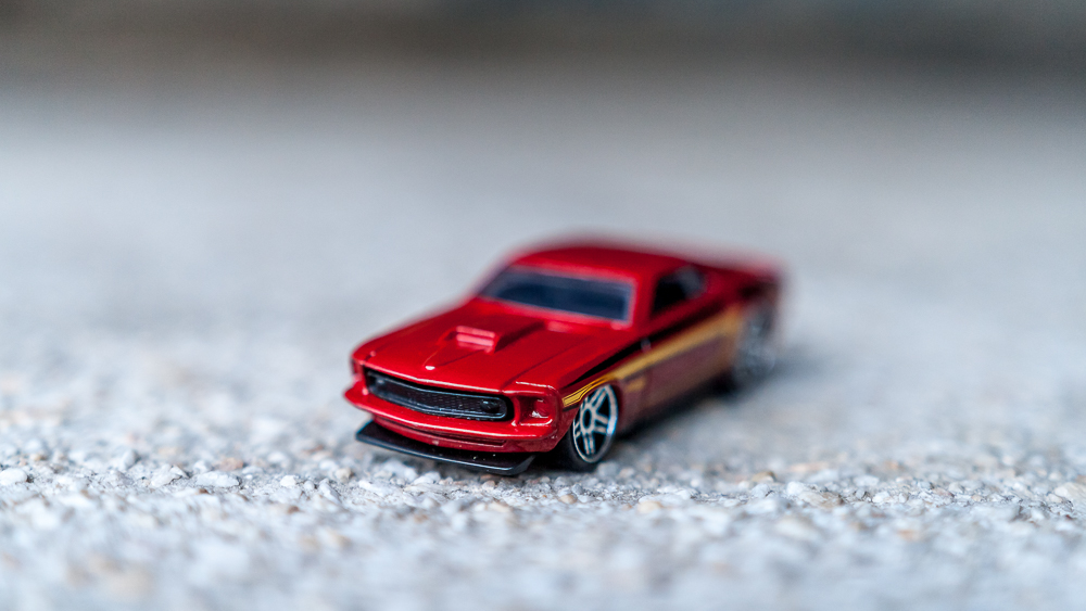 1:64 scale Hot Wheels model car shot at f/1.8 on 35mm on a crop sensor. Using the Sigma 18-35mm at its minimum focusing distance. No extension tubes. As you can see it can barely cover 1/10th of the model car.