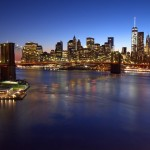Brooklyn Bridge, Downtown Manhattan, and One World Trade Center, blue hour by John Cunniff