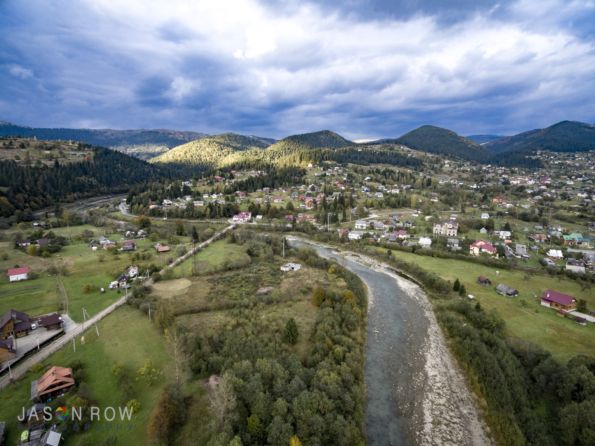 The mountains take on a different perspective from the air. By Jason Row Photography