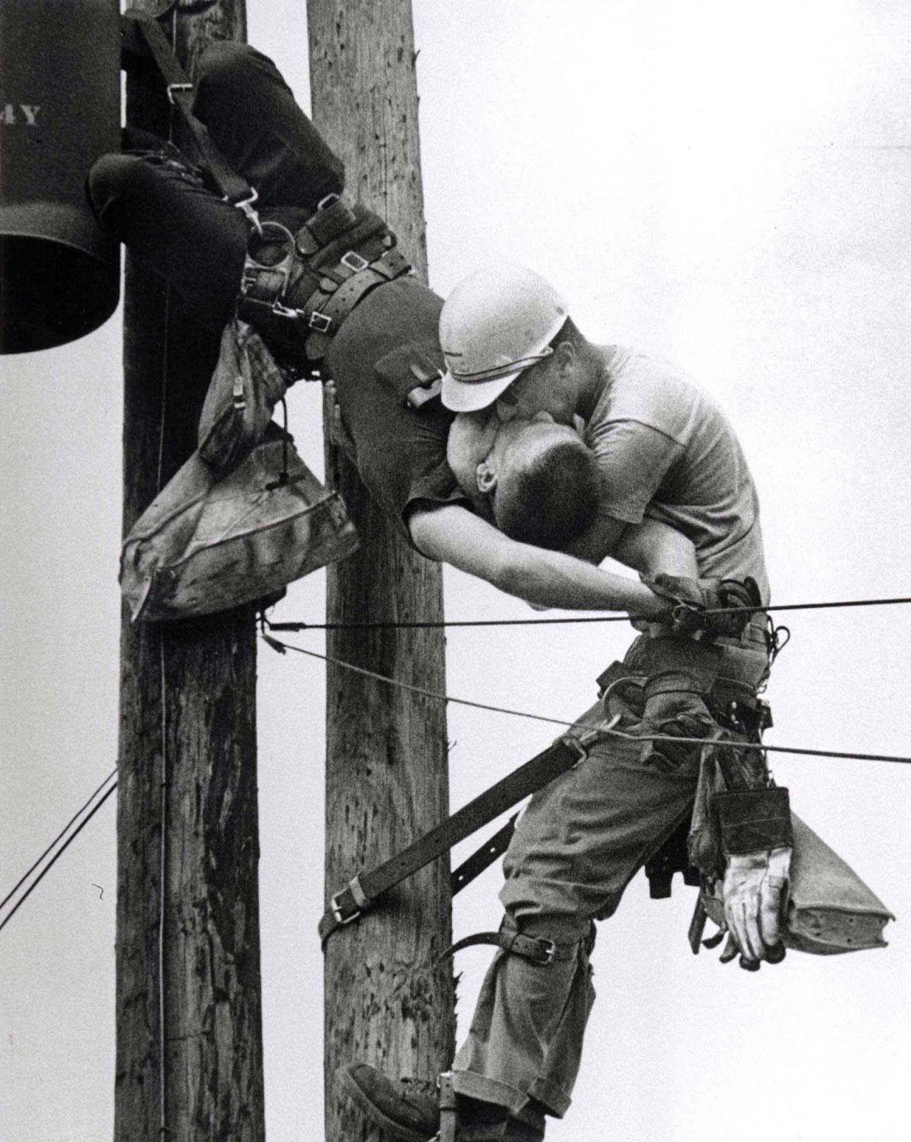 the-kiss-of-life-a-utility-worker-giving-mouth-to-mouth-to-co-worker-after-he-contacted-a-high-voltage-wire-1967