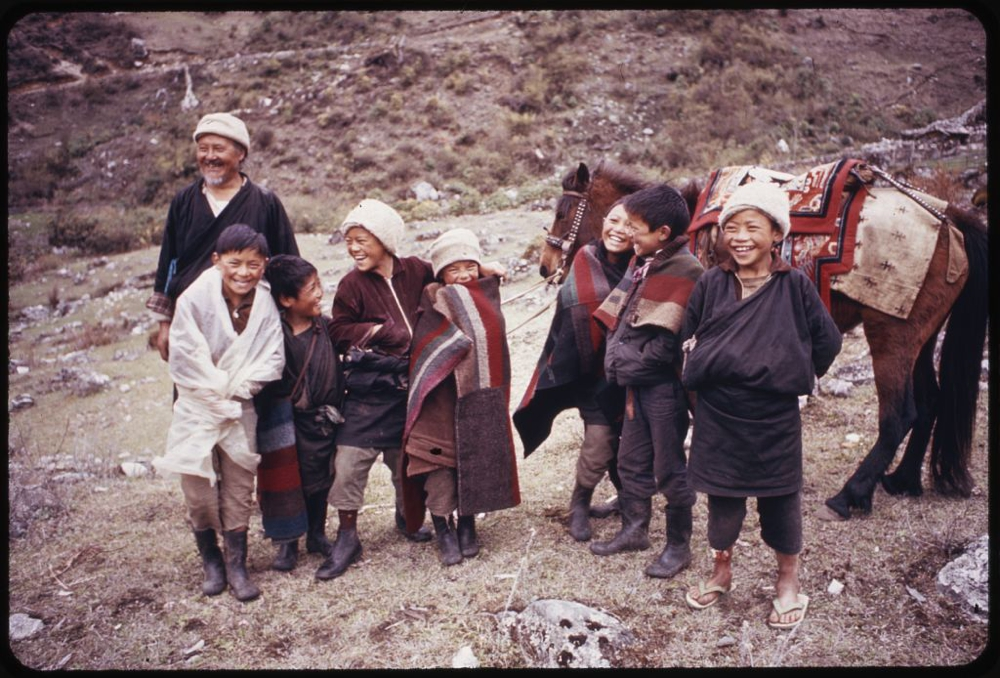 Photograph shows headman of village, Pipon, with group of children and a horse, Lachung, Sikkim