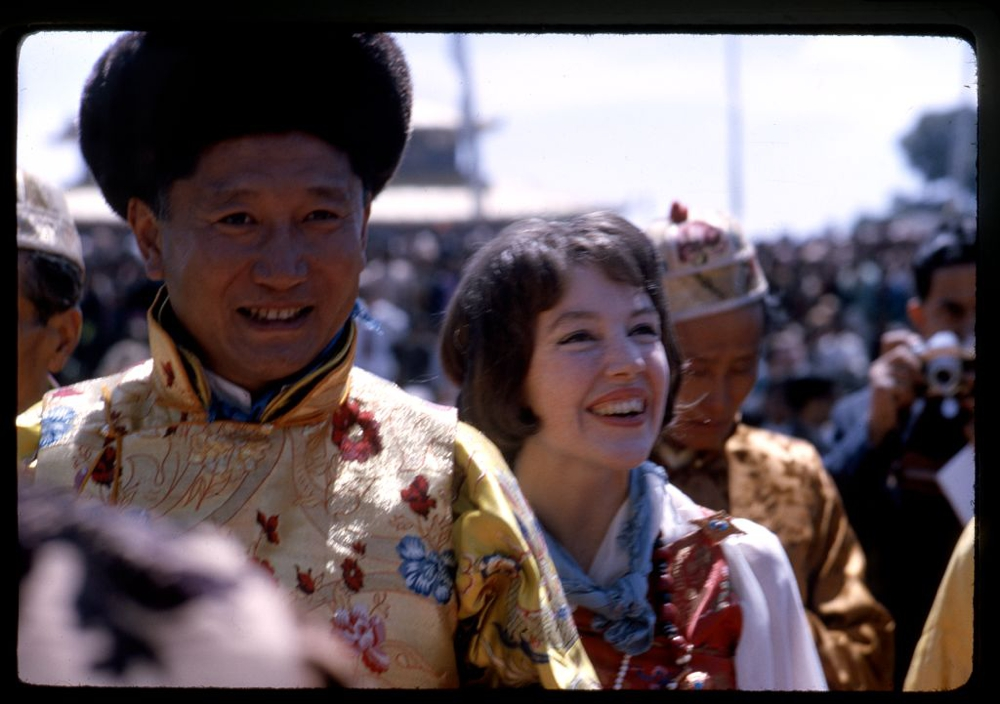 Photograph shows the newly-crowned King Palden Thondup Namgyal and Queen Hope Cooke walking in procession, Gangtok, Sikkim.