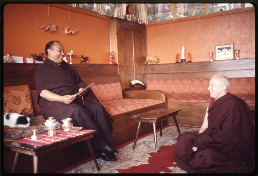 Rangjung Rigpe Dorje, the 16th Karmapa Lama, seated, with a monk, at Rumtek Monastery, Sikkim