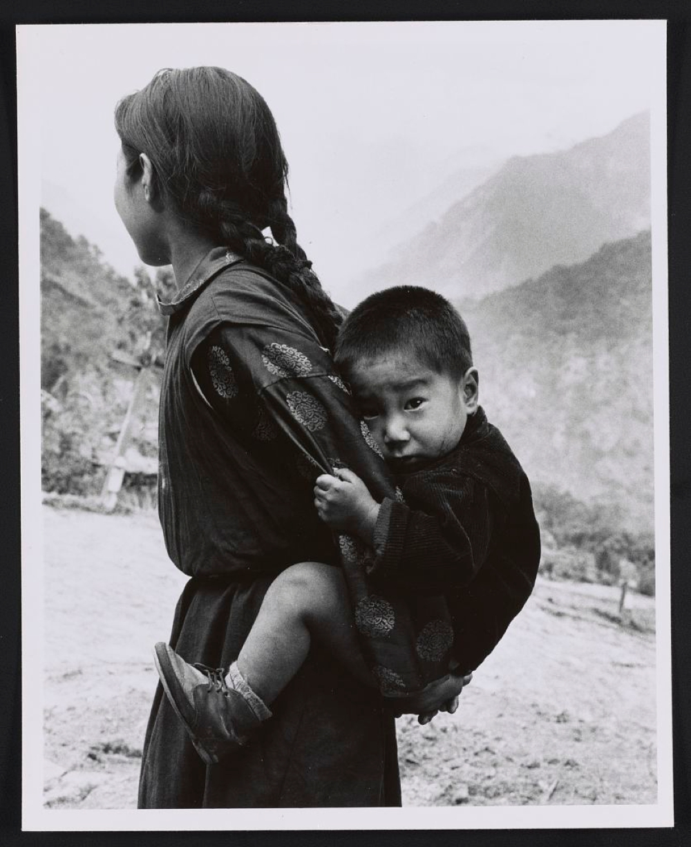 Young woman with a small child on her back, Sikkim
