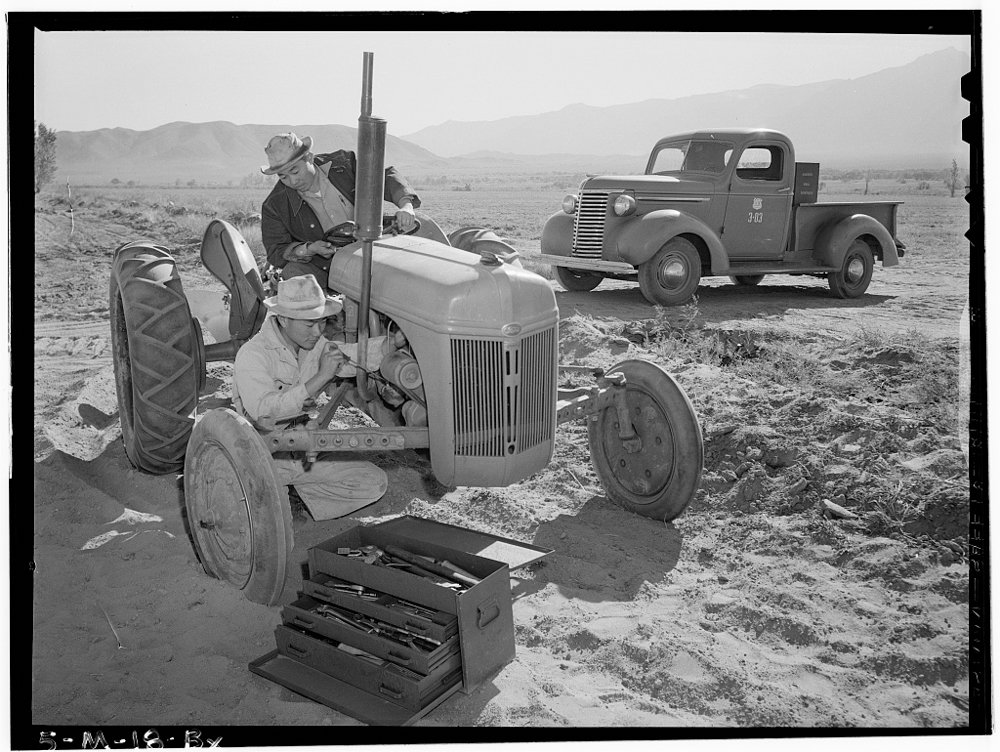 Tractor repair: Driver Benji Iguchi, Mechanic Henry Hanawa, Manzanar Relocation Center, California