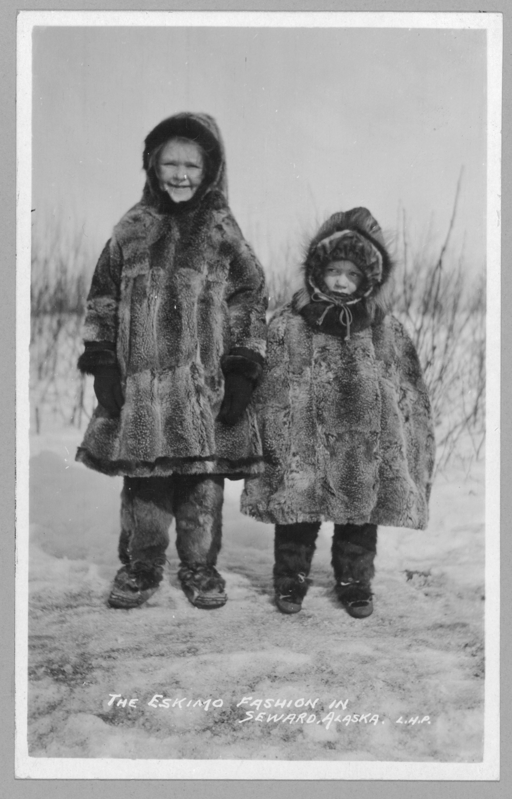 Children in Eskimo fur clothing