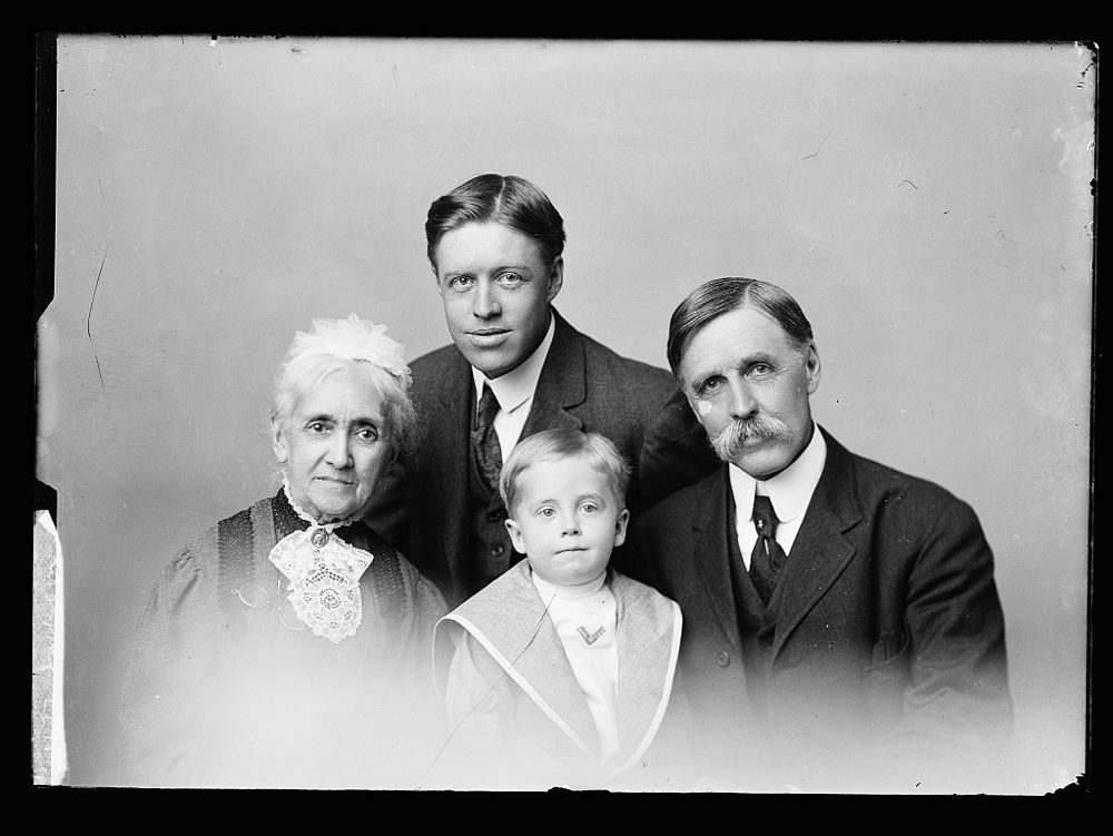 [William Henry Jackson (right) with his mother, Harriet Jackson (left), his son Clarence S. Jackson and young son Billy (center) in a family portrait]