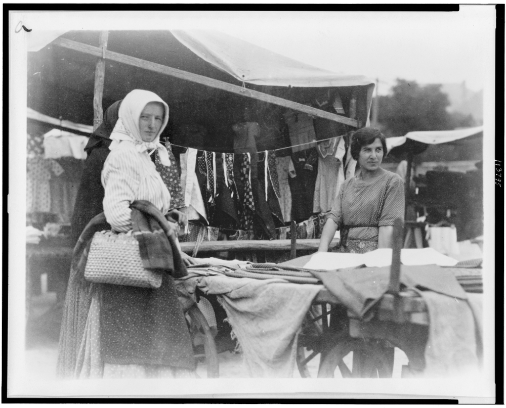 Woman shopping for textiles at market, Hungary