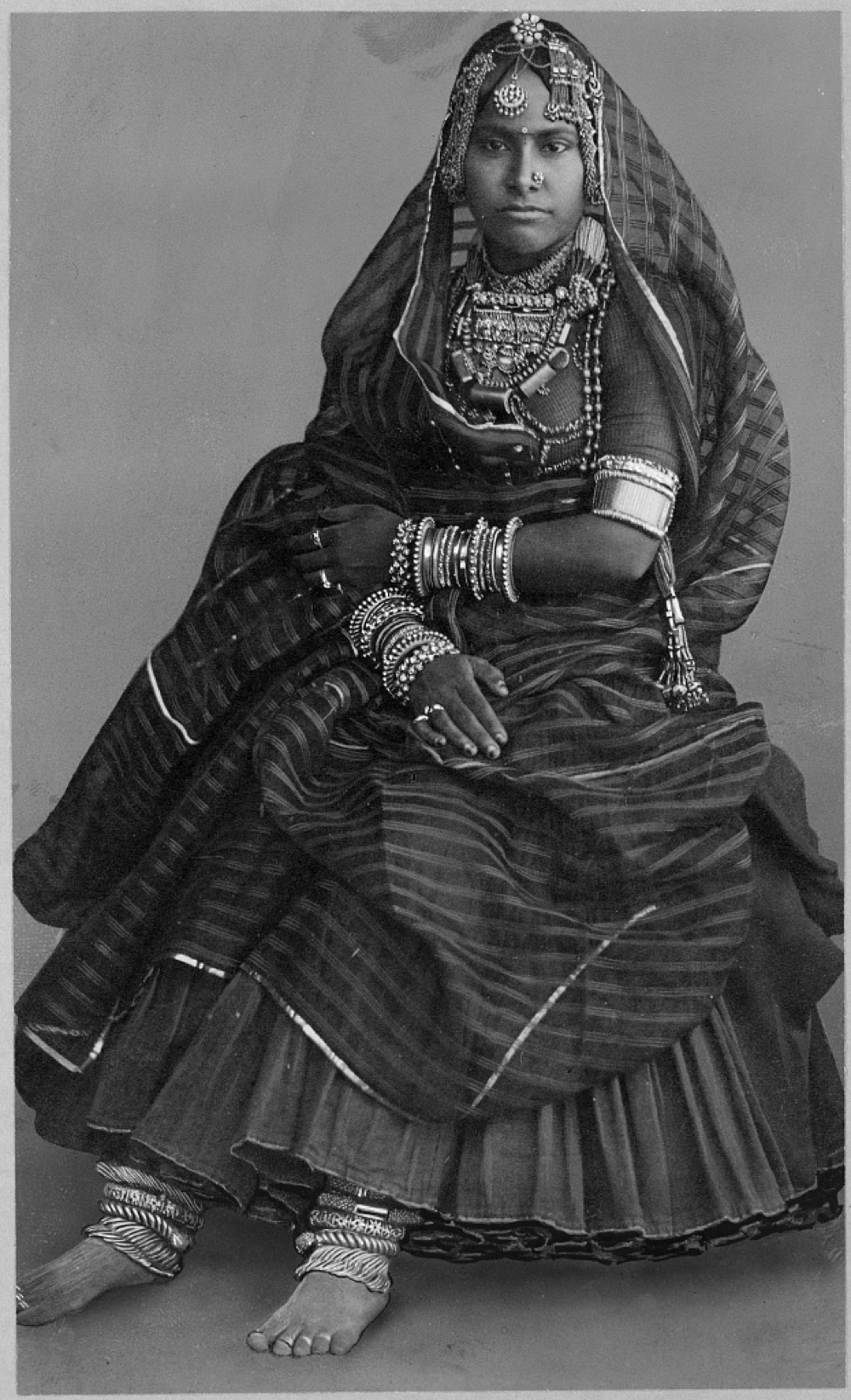 Woman wearing court dress and Indian jewelry