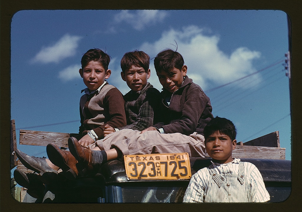 Boys sitting on truck parked at the FSA