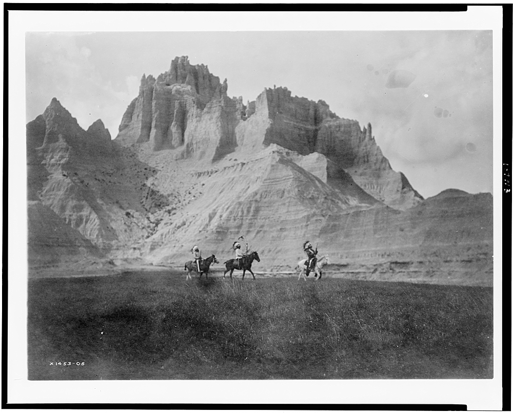 [Entering the Bad Lands. Three Sioux Indians on horseback]