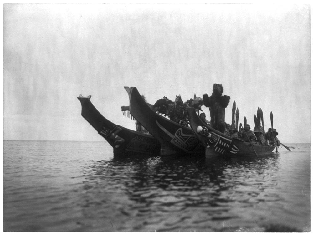 Masked dancers in canoes --Qagyuhl