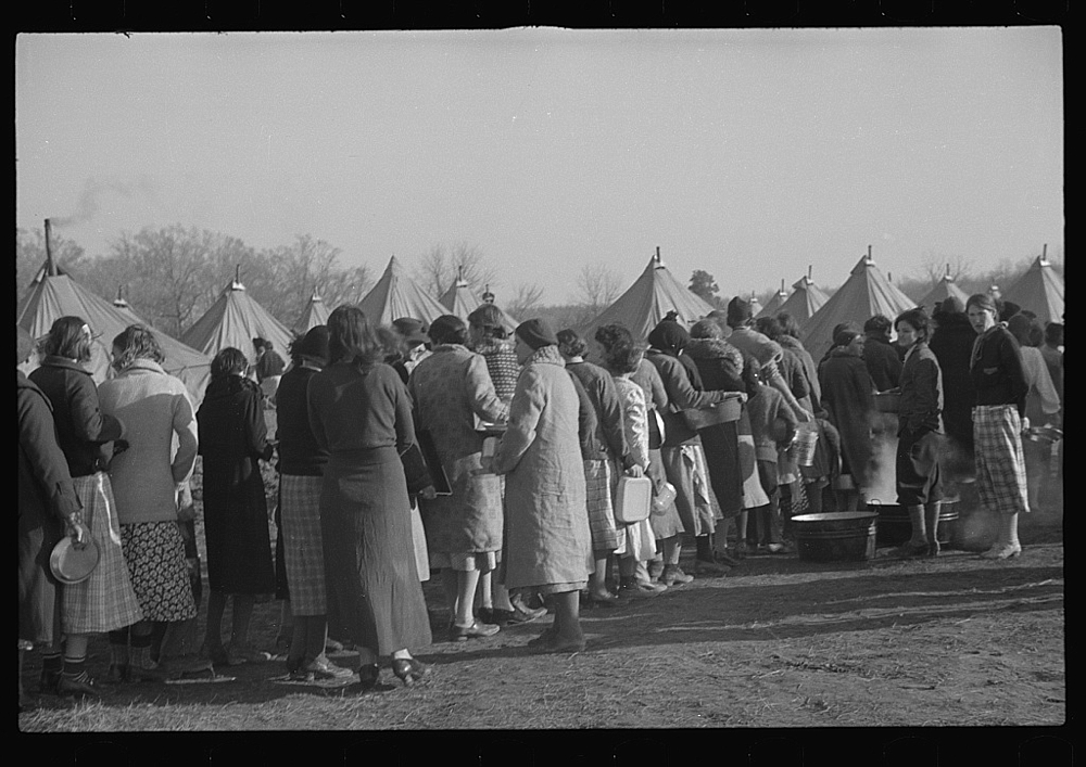 Refugees lined up at meal time in the camp