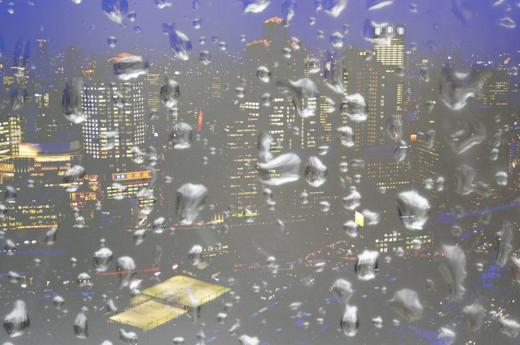 Raindrop textures blended over a cityscape using Lighten blend