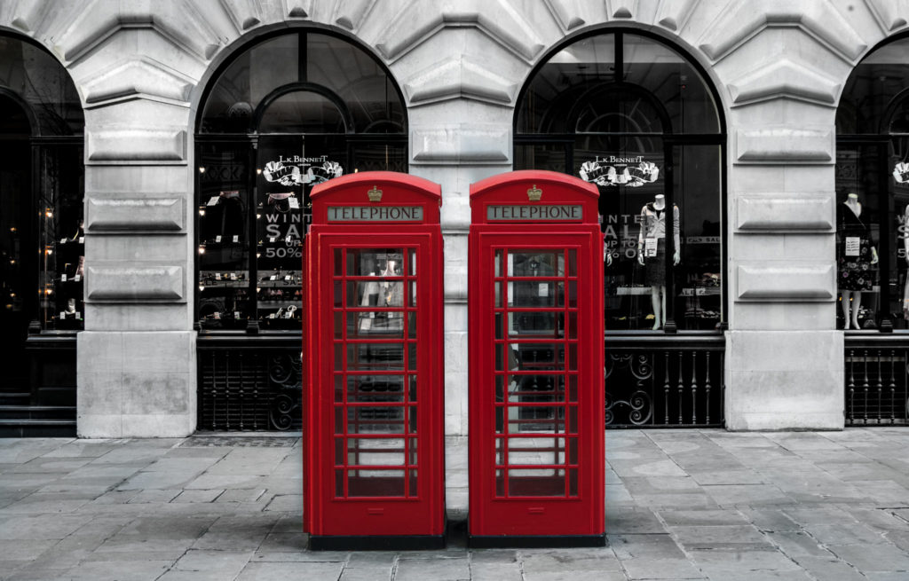 Two British red telephone boxes back to back