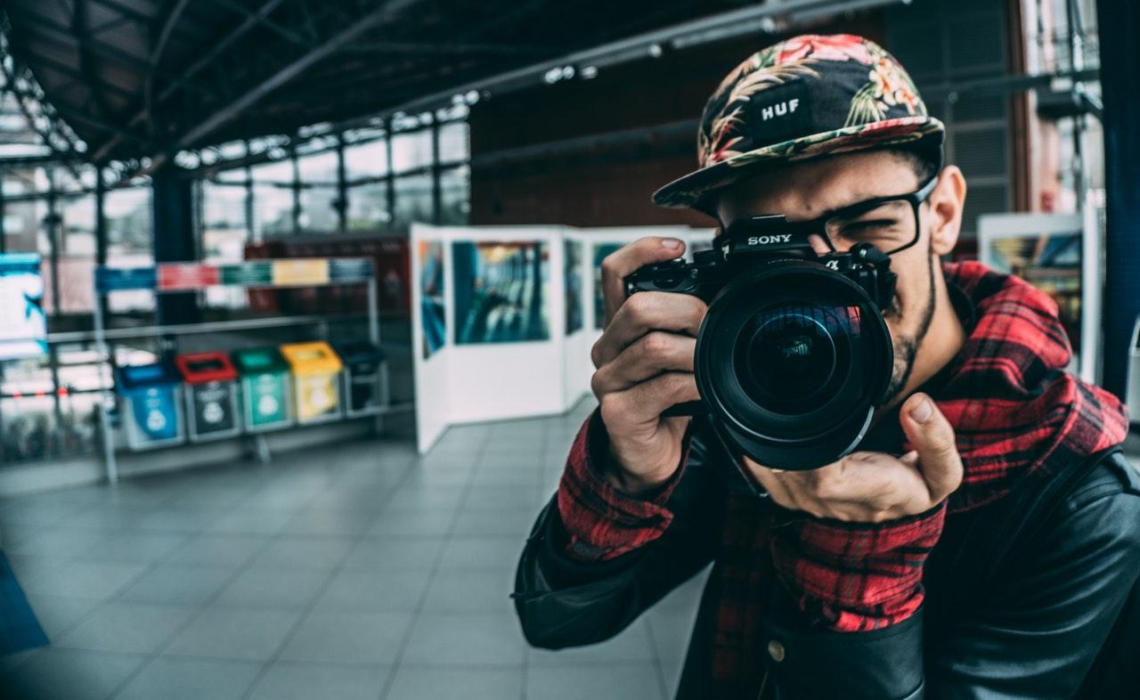 adult blur business camera