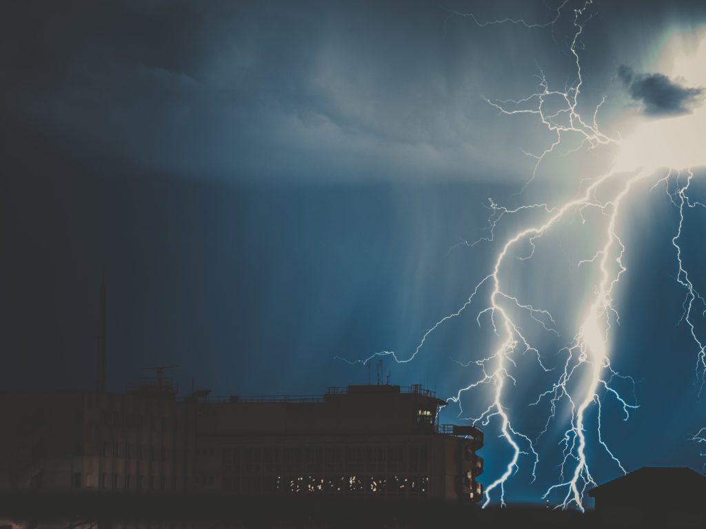 Lightning striking building.