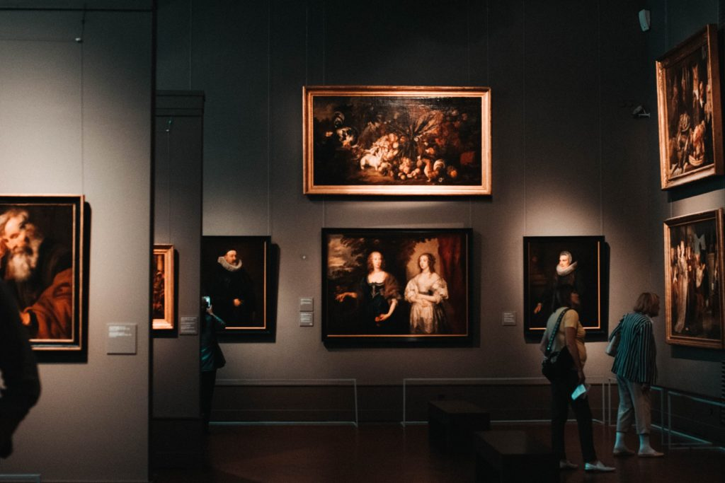 Person looking at portraits in an art gallery