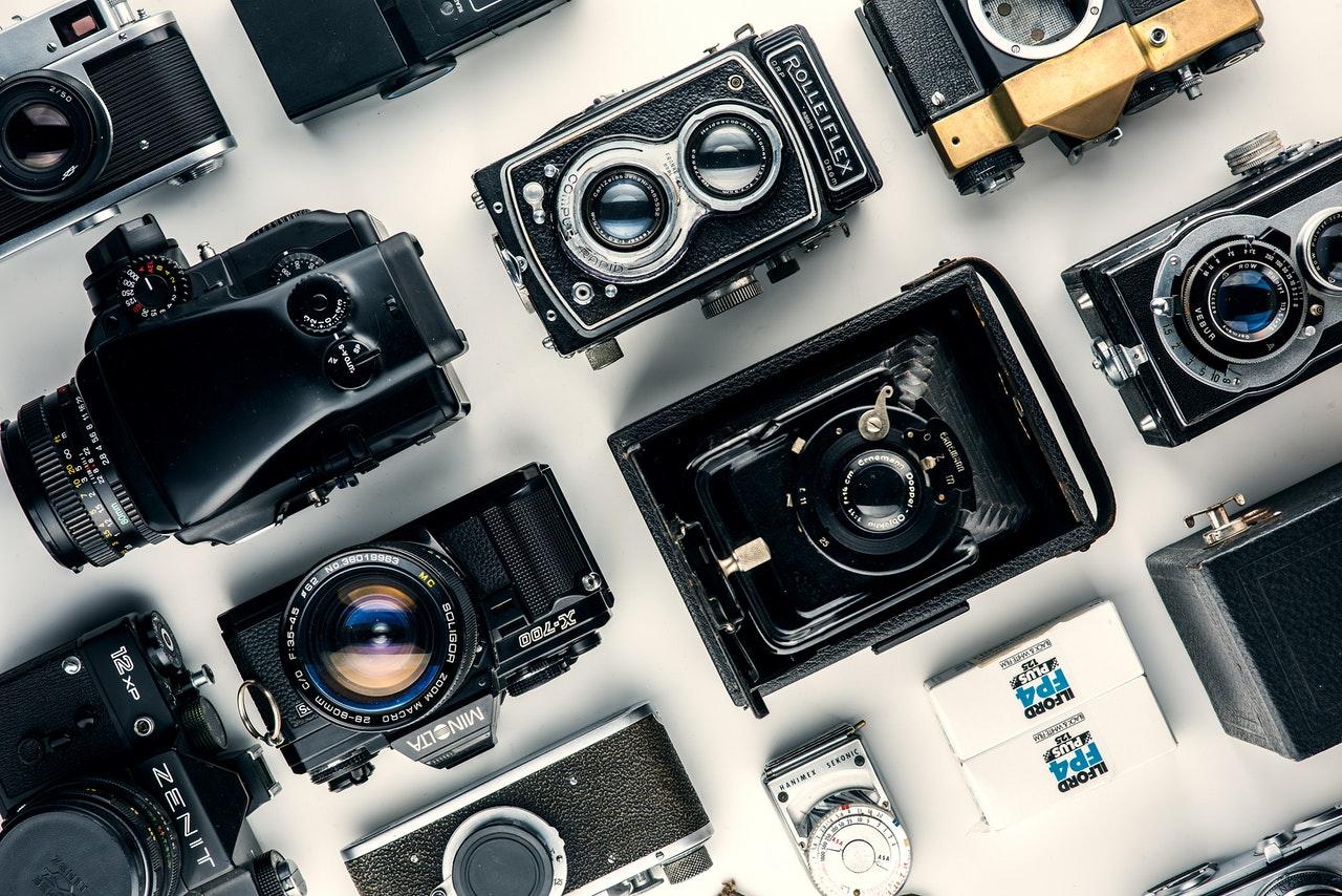 assorted black and gray cameras