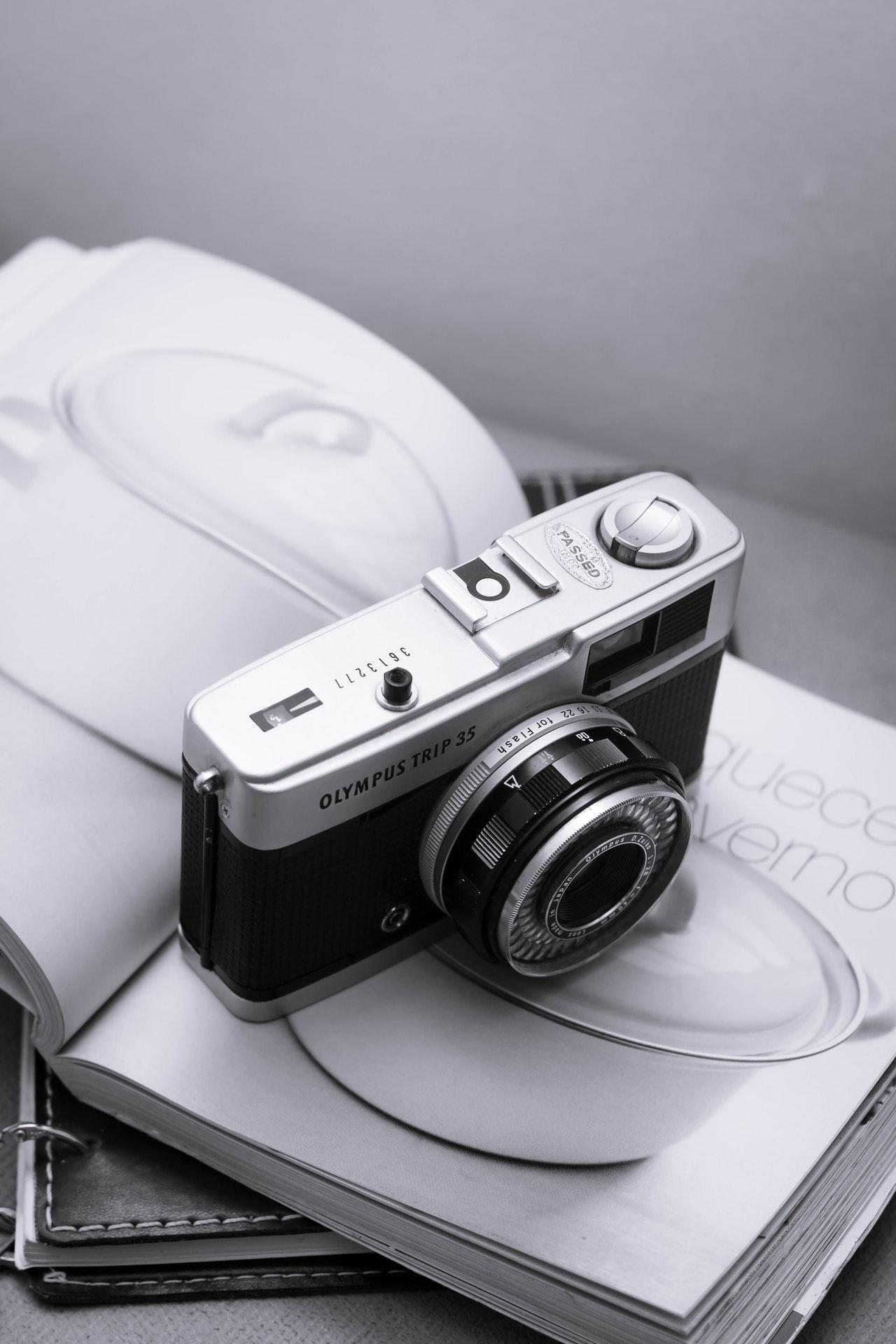 black and silver camera on white magazine