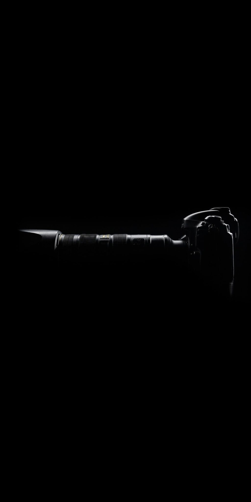 black and white black background camera camera equipment