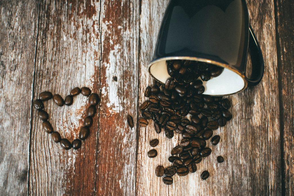 black ceramic coffee mug and beans