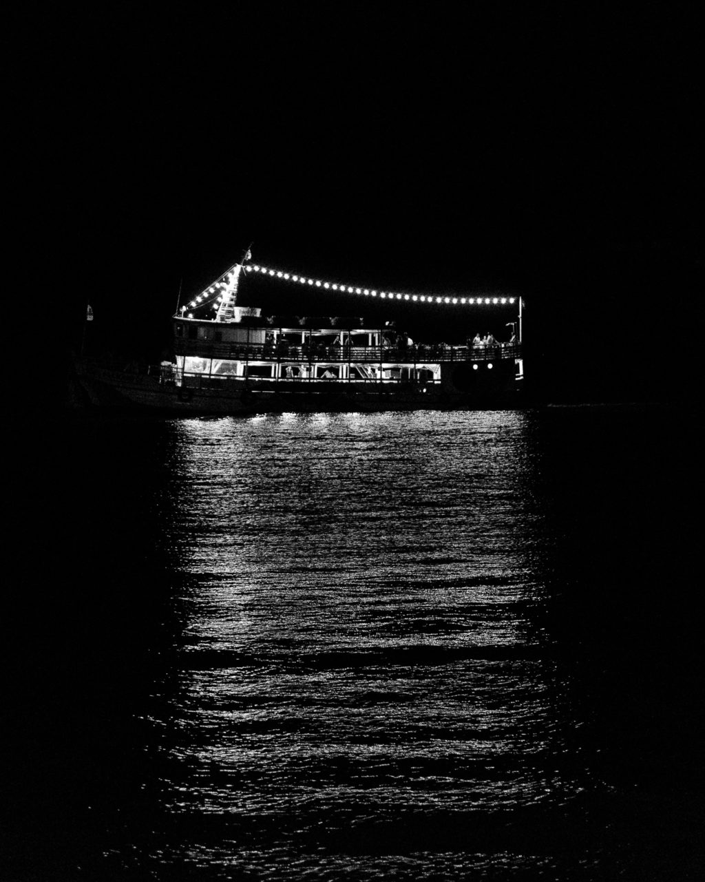 River with boat in black and white