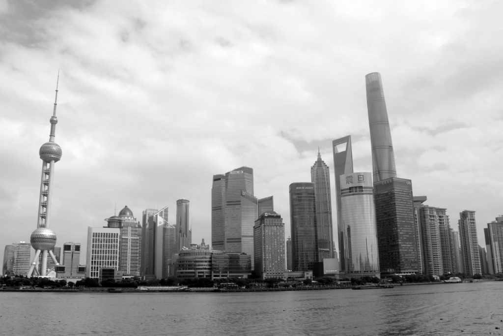 River with city skyline in black and white