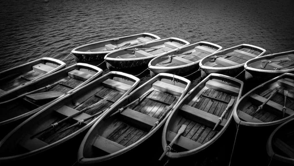 River with boats in black and white