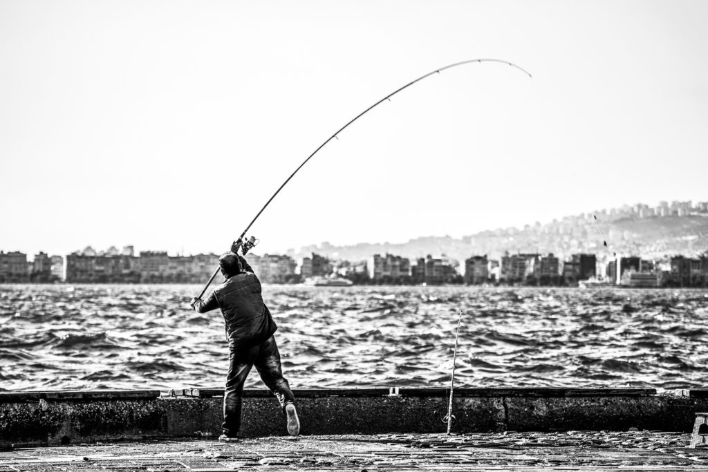 River with fisherman in black and white