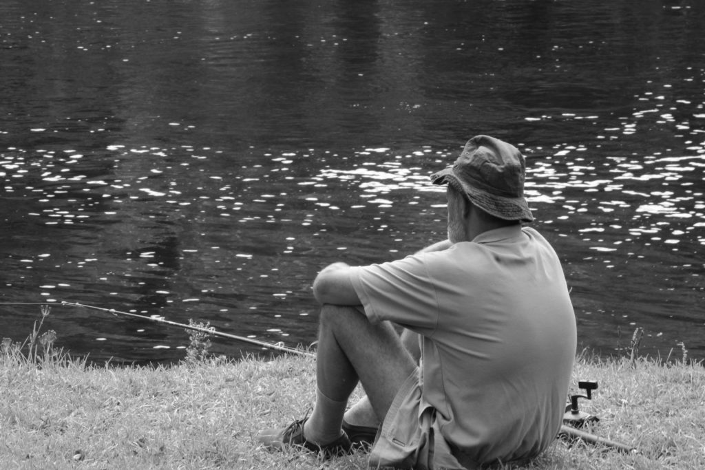 River and fisherman in black and white