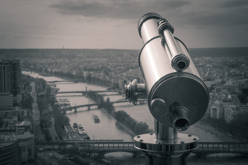 River and telescope and city in black and white