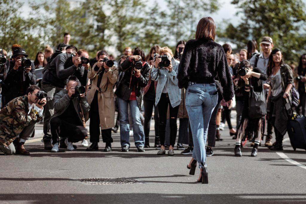Photographers taking shot of model