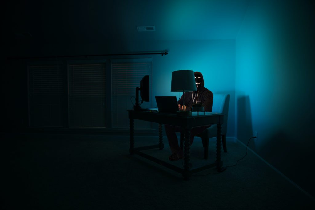 Anonymous type hacker at computer