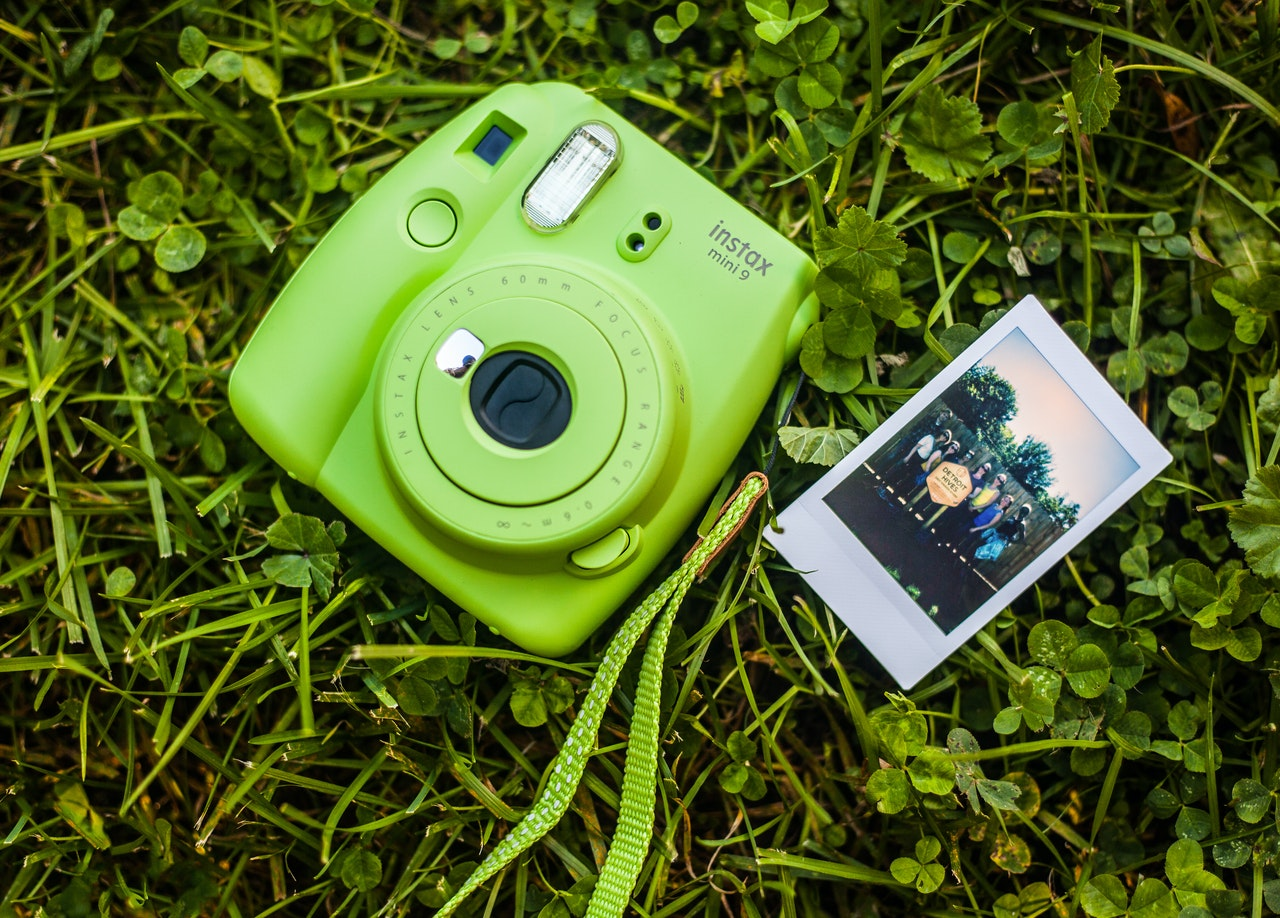 close up photography of camera on grass