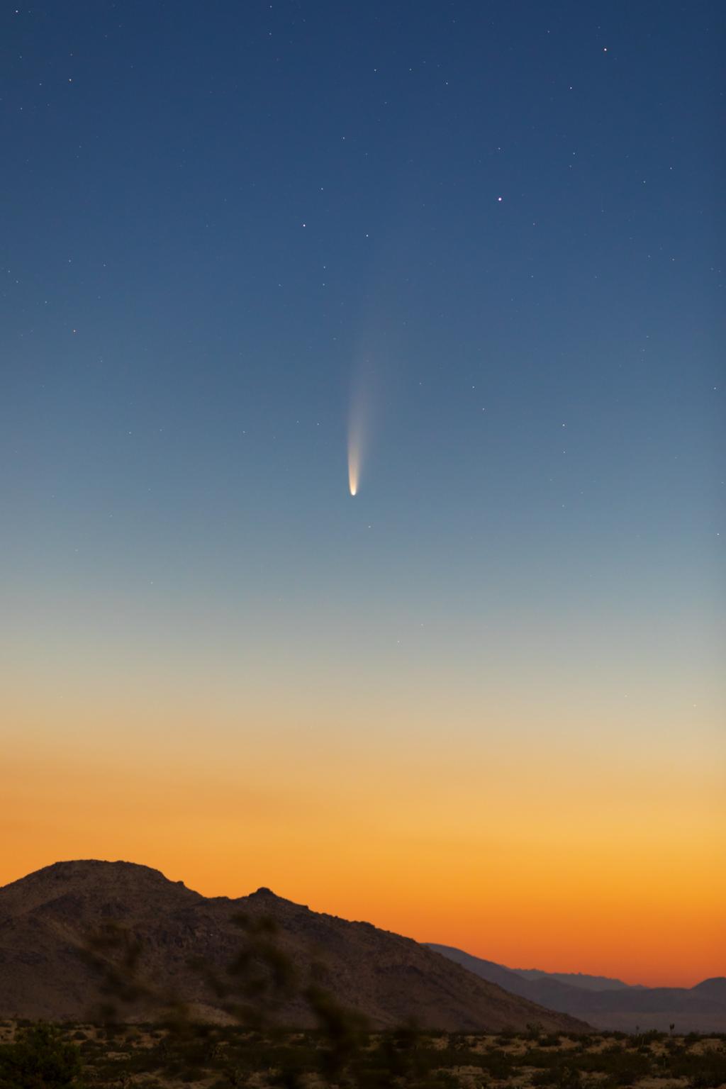 comet c f neowise over california desert landscape
