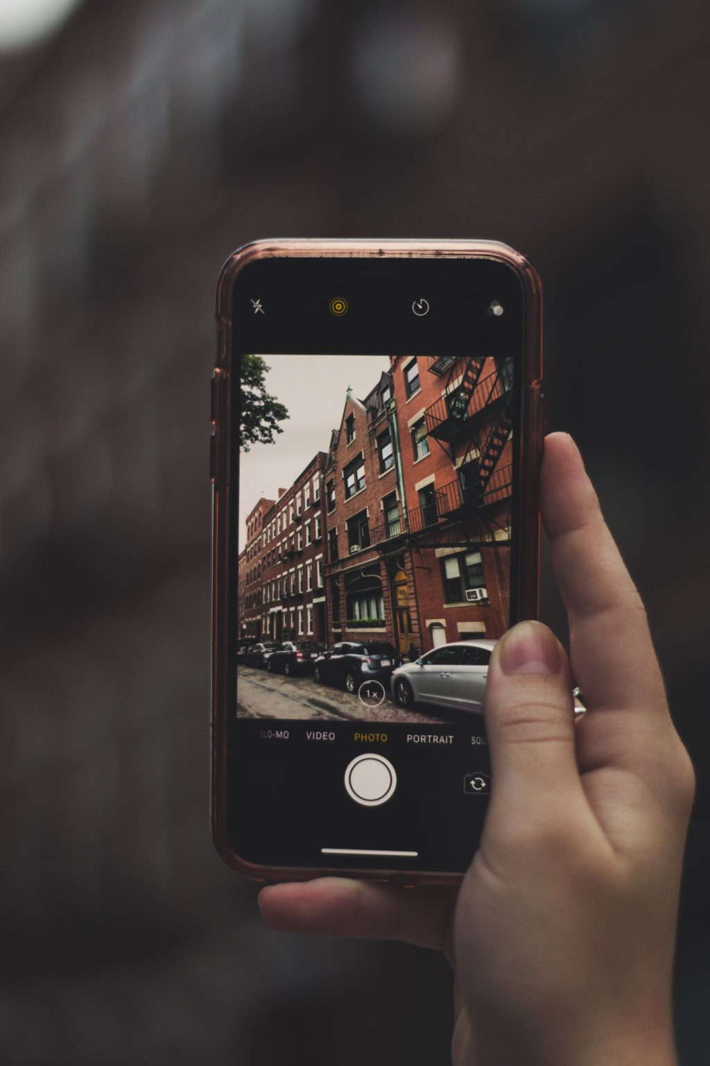 Old iPhone taking a photo of a building