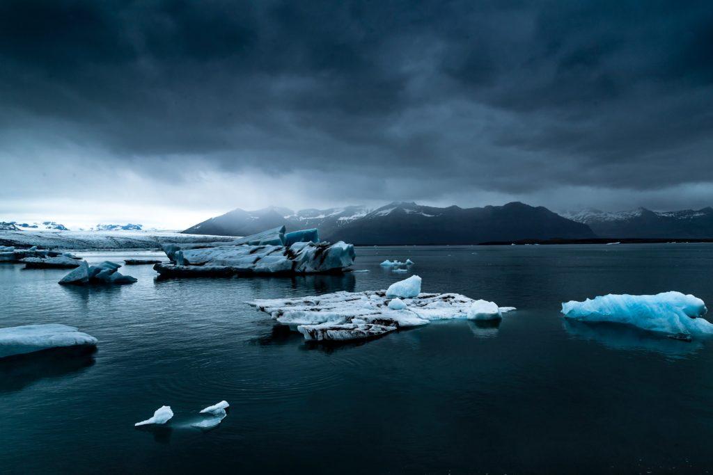 Blue artic scene with icebergs