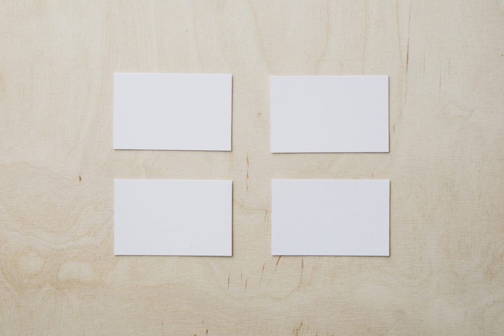 empty white business cards on wooden table