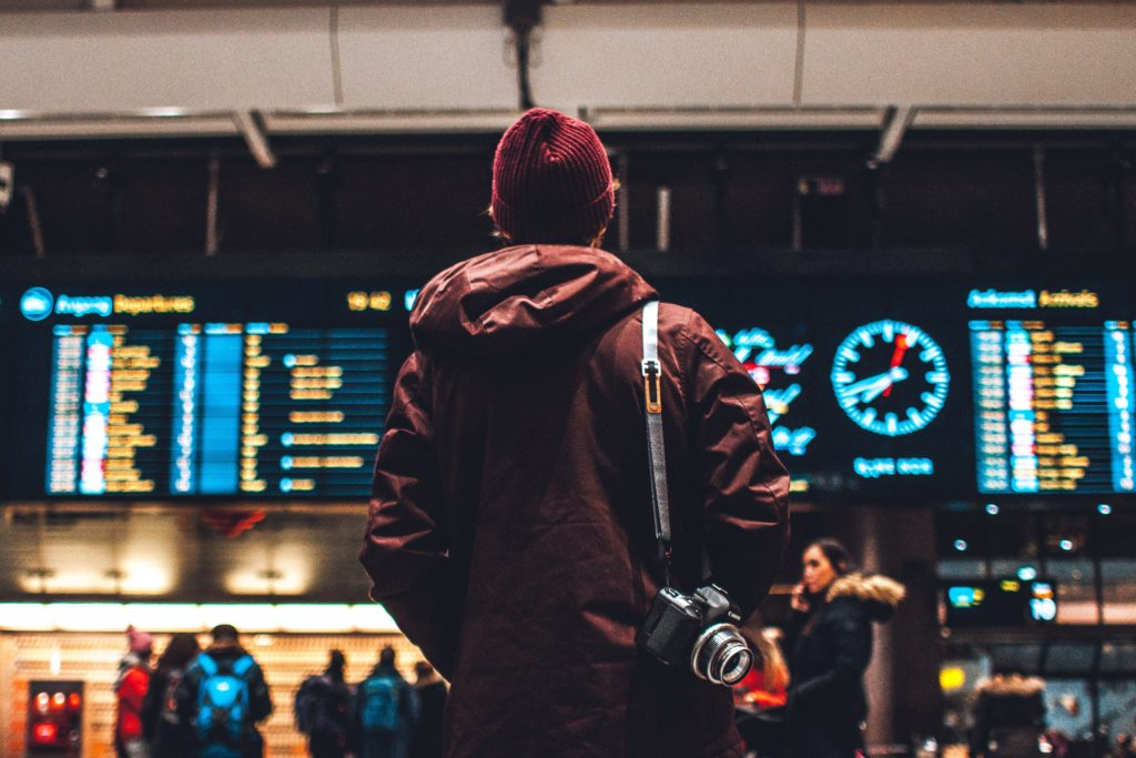 travel photographer in airport