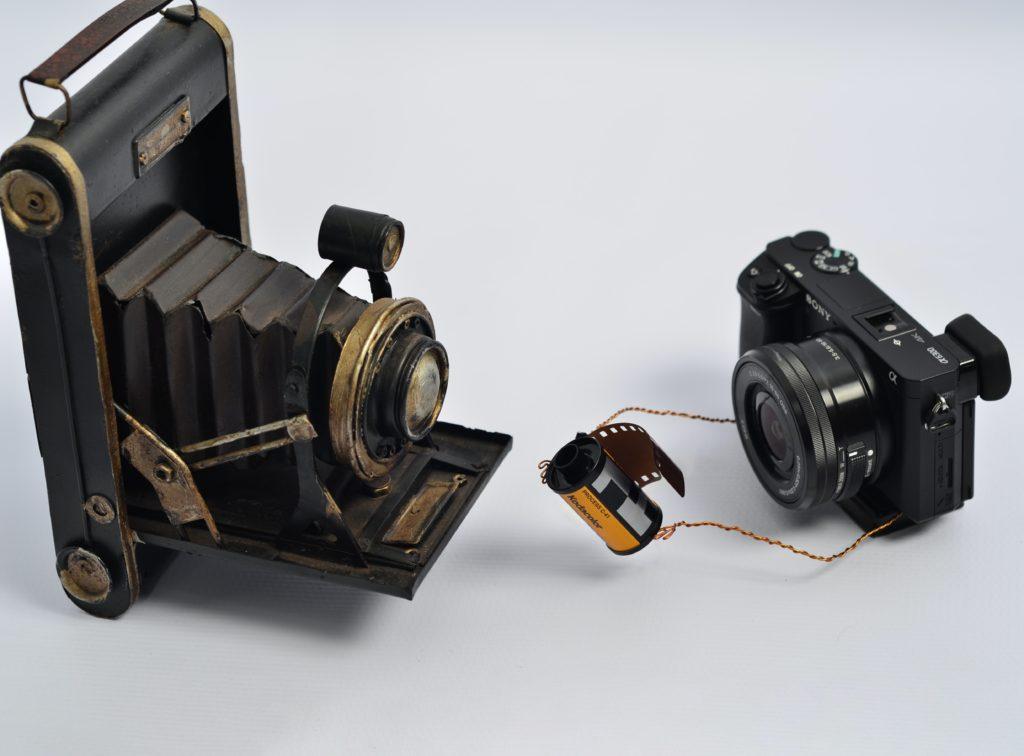 Old film camera with modern digital camera