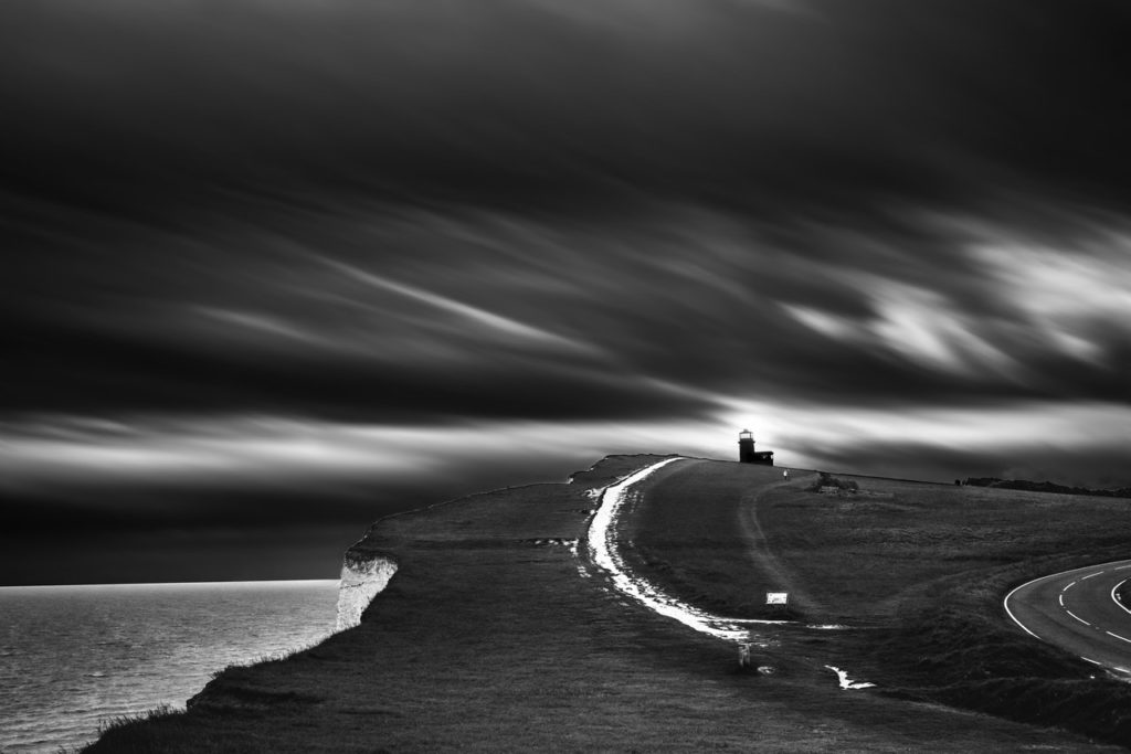grayscale photography of cliff