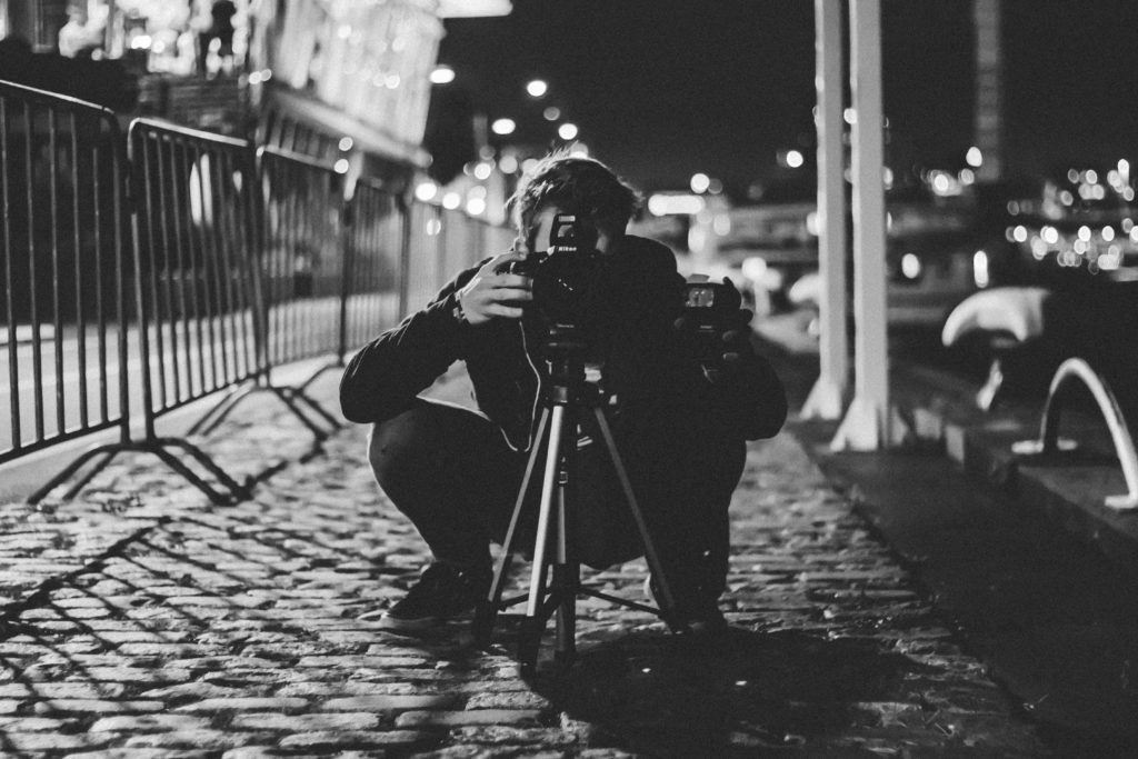 Photographer shooting street late at night